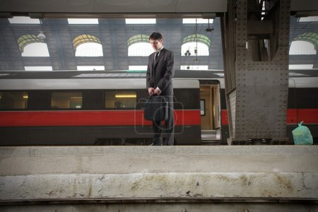 Photo for Businessman standing on the platform of a train station - Royalty Free Image