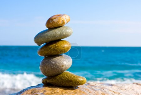 Photo for Balanced wet stones on the sea - Royalty Free Image