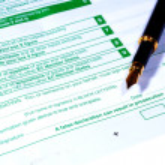 UK VAT Form with black fountain pen...