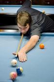 Caucasian man playing pool