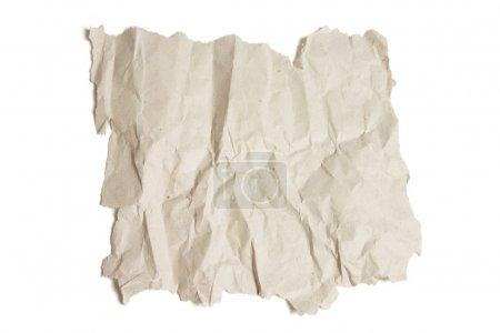 Photo pour Pièce de papier froissé sur fond blanc - image libre de droit