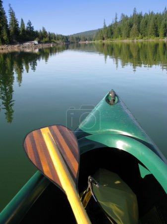 Photo for Canoe and Beautiful Wooden Paddle on Lake - Royalty Free Image