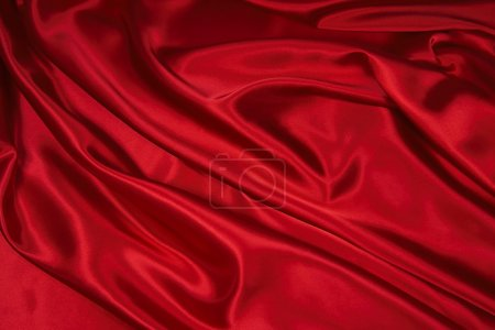 Photo for Luxurious deep red satin/silk folded fabric, useful for backgrounds - Royalty Free Image