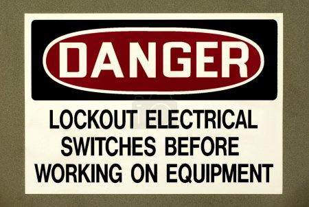 Industrial warning sign to lockout all electrical switches before working on equipment