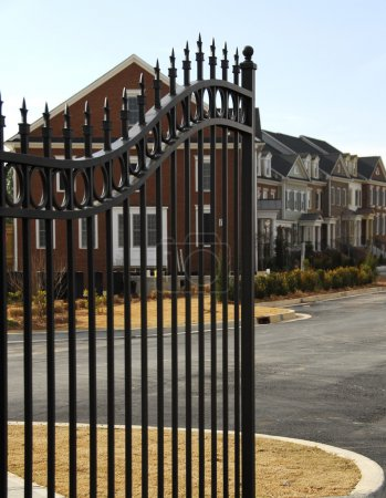 Photo for New Gated Community with focus on the security gate - Royalty Free Image
