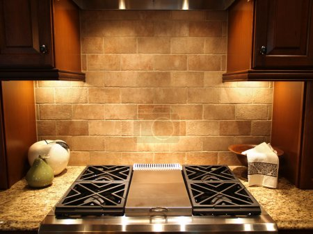 Photo for A modern cooktop in a kitchen in an upscale luxurious american home - Royalty Free Image