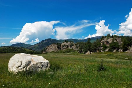 Rural mountain valley and big stone