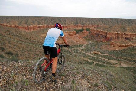 Mountain biker downhill to Canyon