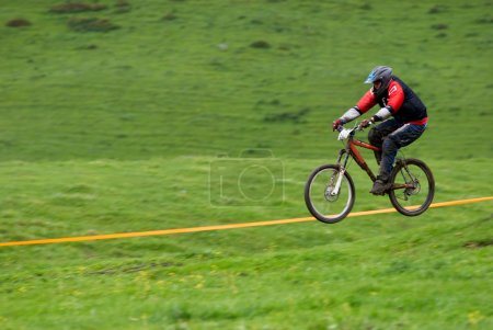 Blurred motion fly on downhill bike race