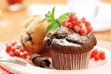 Photo for Two fresh muffins styled with red currant - Royalty Free Image