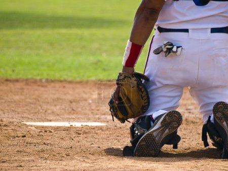 Baseball catcher behind the homeplate