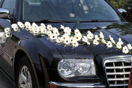 Photo for Dark car decorated with white flowers - Royalty Free Image
