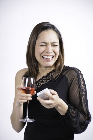 Woman crying holding a glass of wine