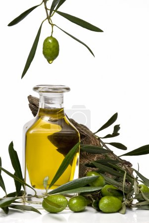 Photo for Olive oil bottle and a branch with olives isolated on white background. - Royalty Free Image