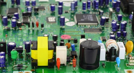 Photo for The modern printed-circuit board with various electronic components. In the foreground power supply components. Selective focus. - Royalty Free Image