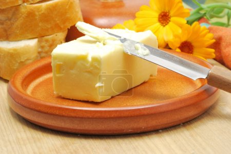 Butter on ceramic plate on kitchen table...